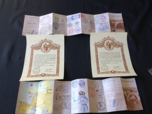 Our pilgrims passports, stamped with all the places we stayed, and  our Compestellas, for accomplishing the Camino
